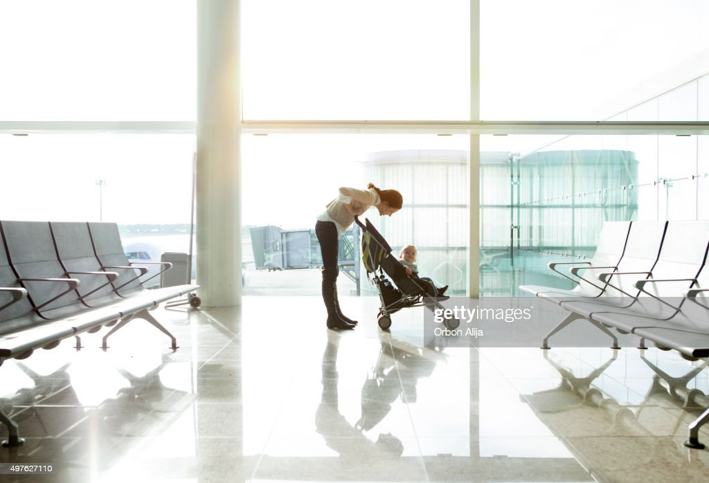Mother with baby at the airport : Stock Photo