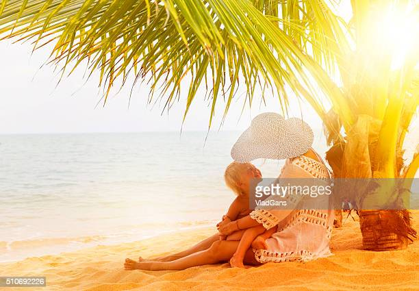 Mother with baby at tropical beach