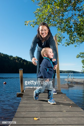 Mother with baby boy on jetty