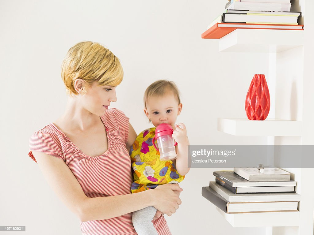 Mother with baby daughter (12-17 months) : Stock Photo