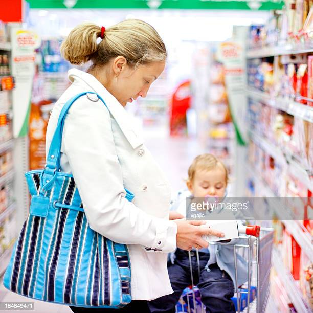 Mother with baby girl shopping in the supermarket