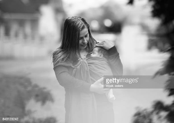 mother with baby girl walking in nature