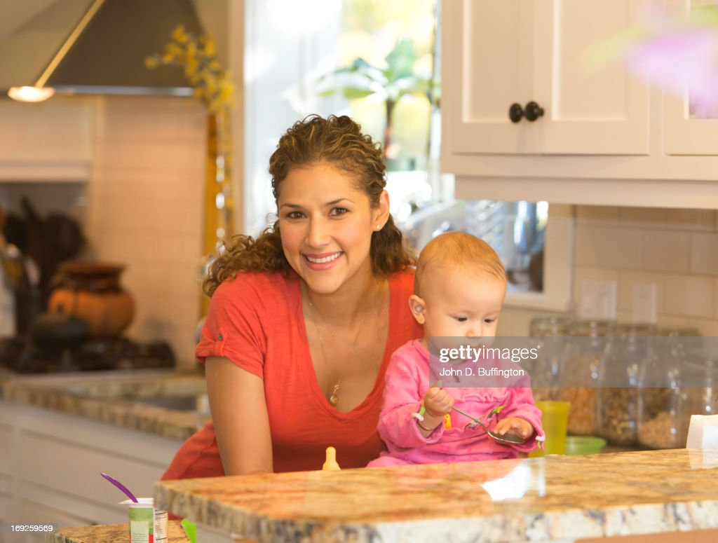 Mother with baby in kitchen : Stock Photo