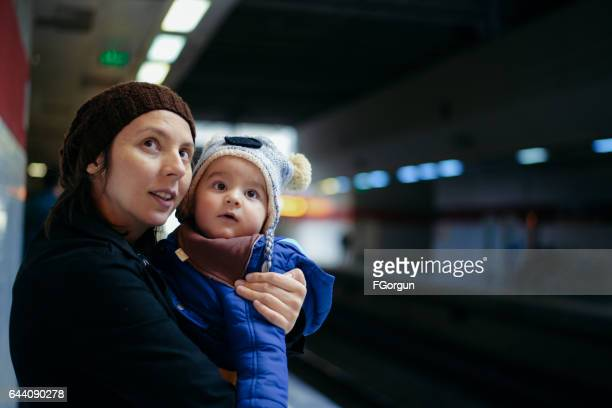 Mother with baby in subway station