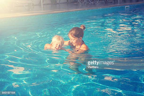 Mother with baby in the swimming pool