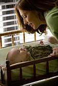 Mother with baby on diaper changing table