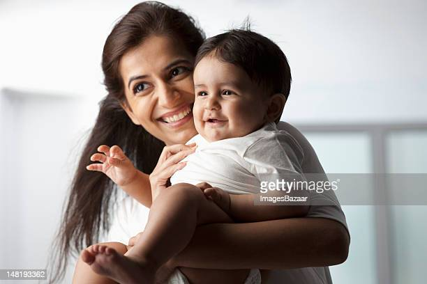 Mother with baby son (12-17 months)
