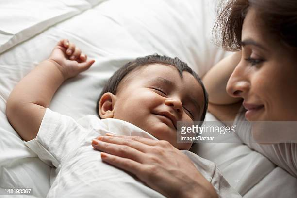 Mother with baby son (12-17 months) sleeping