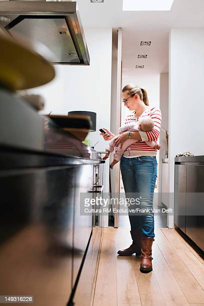 Mother with baby using cell phone