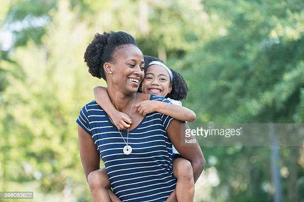 Mother with beautiful mixed race young daughter
