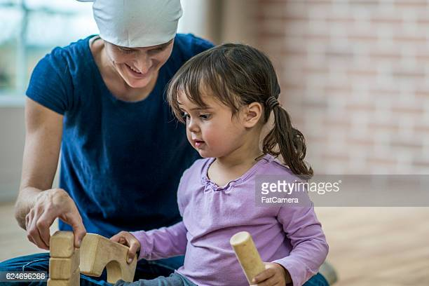 Mother with Cancer Playing with Her Daughter