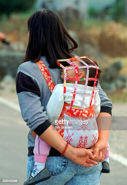 Mother with child in a baby carrier Hong Kong