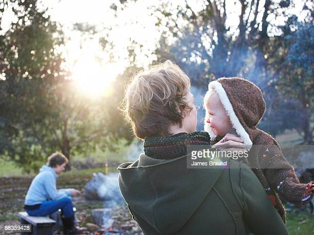 Mother with child in arms camping