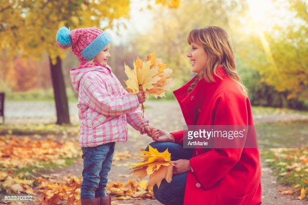 Mother with child outdoors in autumn