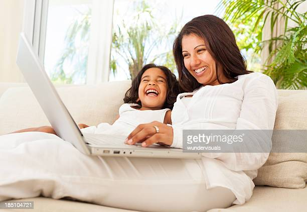 Mother With Daughter Enjoying Movie
