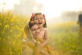 Rural Indian mother and daughter having fun at agriculture field