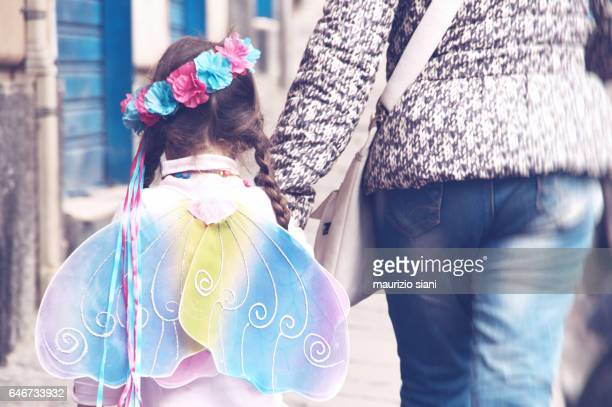 Mother with daughter in a fairy costume