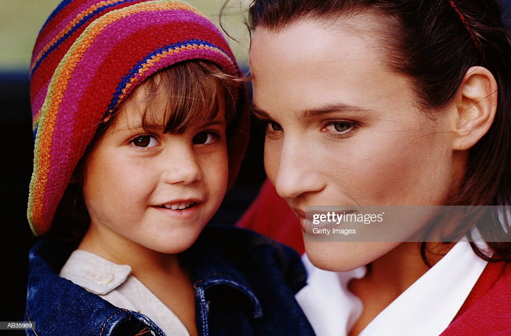 Mother with daughter (2-4) in convertible, close-up : Stock Photo