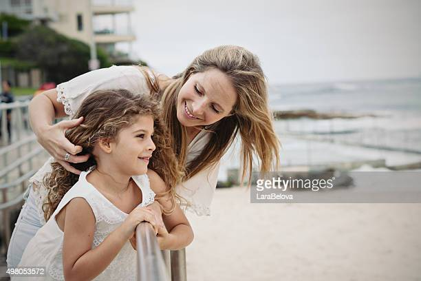 Mother with daughter looking at view