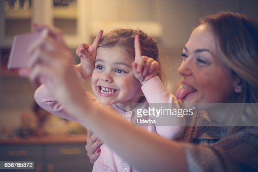 Mother with daughter making funny face. : Foto de stock