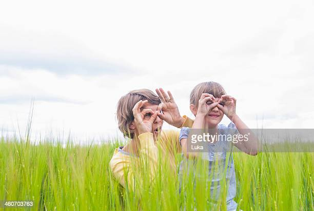 Mother with daughter making pretend binoculars with hands