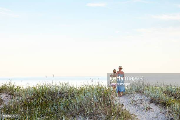 Mother with daughter on beach