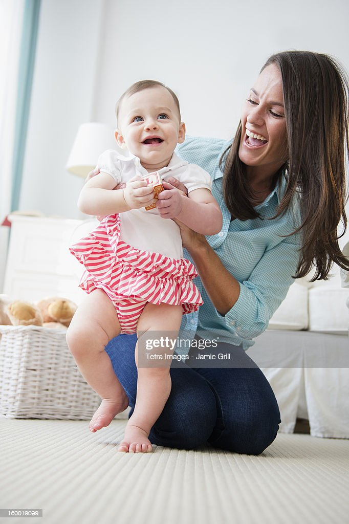 Mother with daughter (6-11 months)