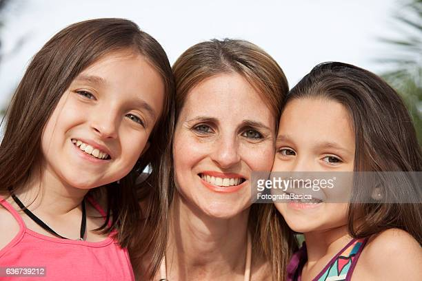 Mother with daughters portrait