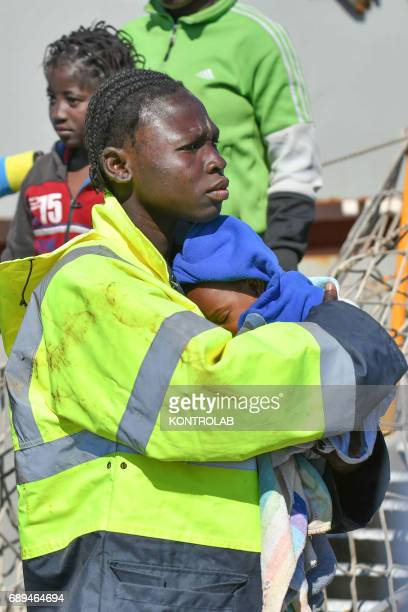 A mother with her baby during the landing of migrants by Turkish cargo ship Kaptan Hilmi III in port of Corigliano Calabria southern Italy The...