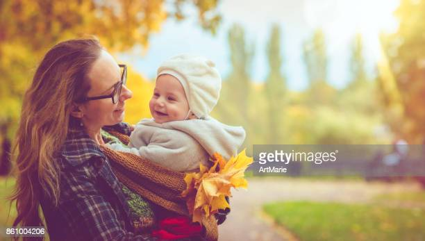 Mother with her baby son in autumn