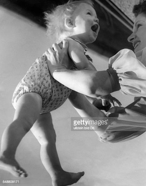 A mother with her child 1939 Photographer Hedda Walther Published by 'Die Dame' 20/1939 Vintage property of ullstein bild