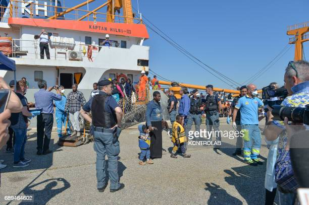 A mother with her children during the landing of migrants by Turkish cargo ship Kaptan Hilmi III in port of Corigliano Calabria southern Italy The...