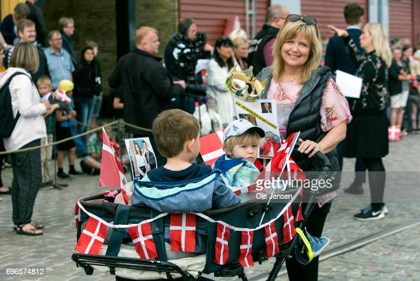 A mother with her children in a decorated baby carriage during Queen Margrethe's arrival with the Royal ship on June 15 2017 in Hobro Denmark The...