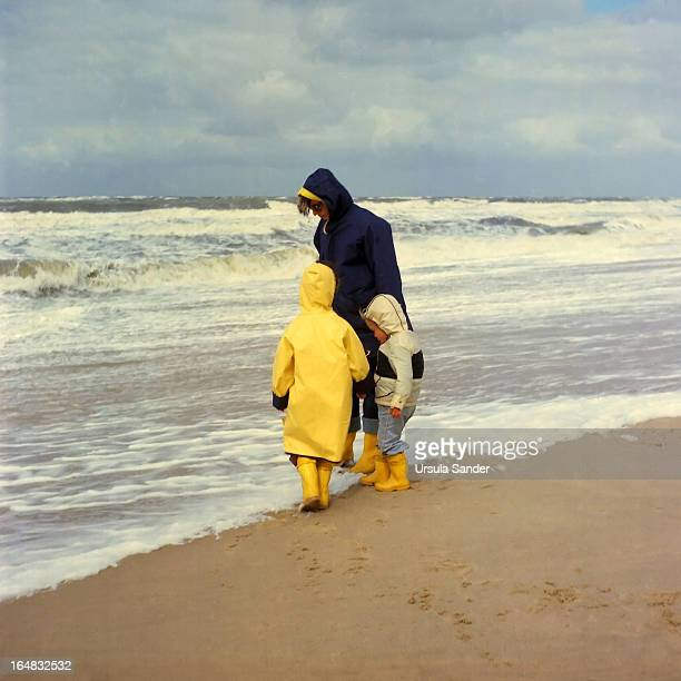 Mother with her children on beach