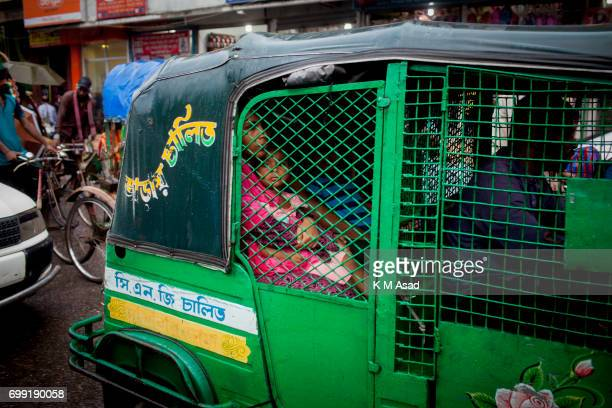 UNIVERCITY DHAKA BANGLADESH Mother with her daughter stuck in the traffic jam when heavy rainfall made in Dhaka city The death toll rises to 156 in...