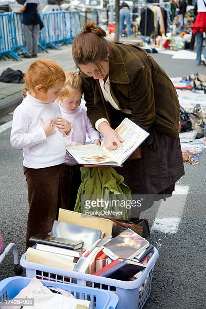 Mother with her girls at the flea market