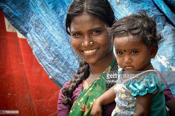 A mother with her little girl on the arm