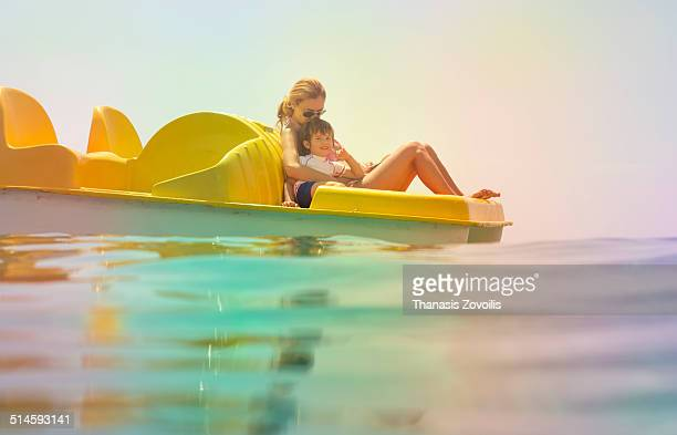 Mother with her son on a paddle boat