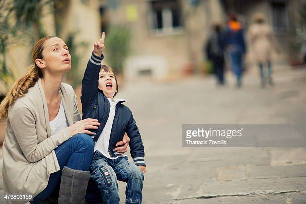 Mother with her son pointing the sky