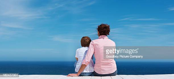 Mother with her son sitting outdoors