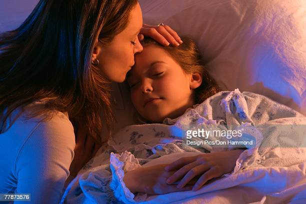 Mother with sleeping daughter