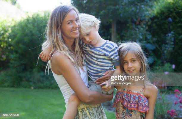 Mother with son and daughter, looking at camera