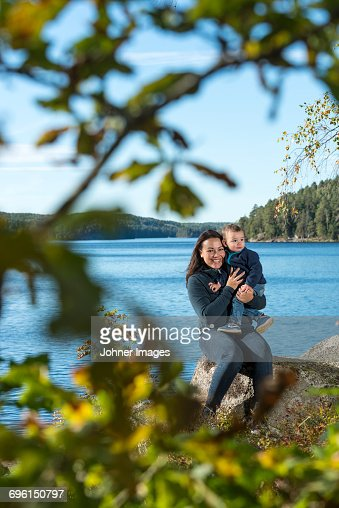 Mother with son at lake