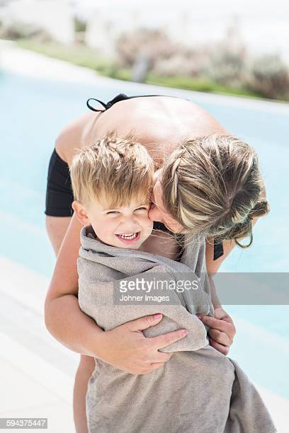 Mother with son at swimming-pool