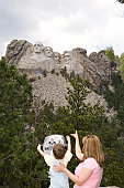 Mother with son (3-5) pointing at Mt. Rushmore Nat'l Memorial