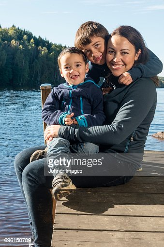 Mother with sons on jetty