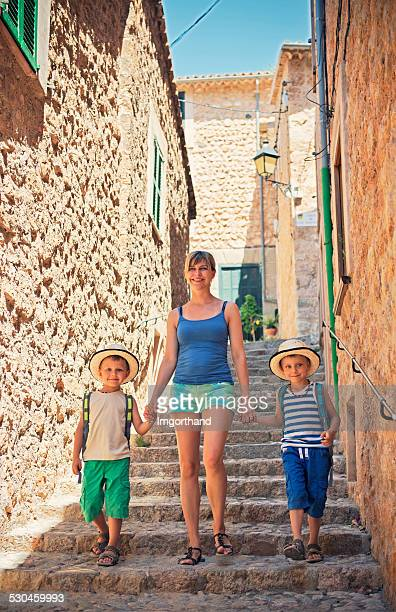 Mother with sons visiting mediterranean town.
