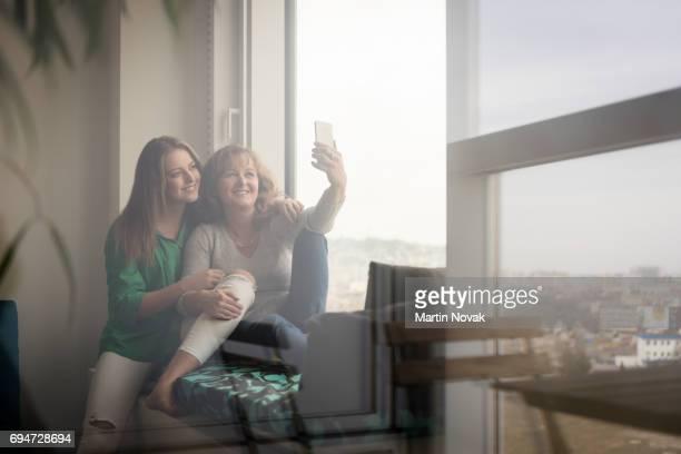 Mother with teen daughter selfie