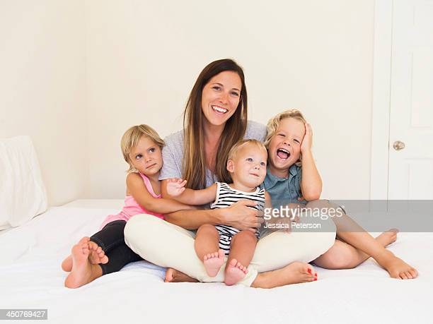 Mother with three kids (6-7, 2-3, 6-11 months)