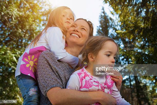 Mother with two daughters (2-5) in park